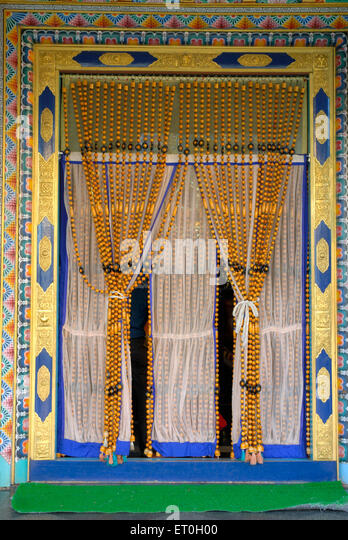 Colourful beaded curtain of Biggest Namdroling monastery at Kushal nagar District Coorg ; Karnataka ; India - Stock Image