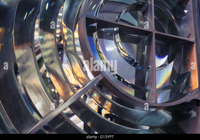 Lighthouse lamp with lens made of glass rings. Closeup photo with selective focus and tonal correction filter effect - Stock Image