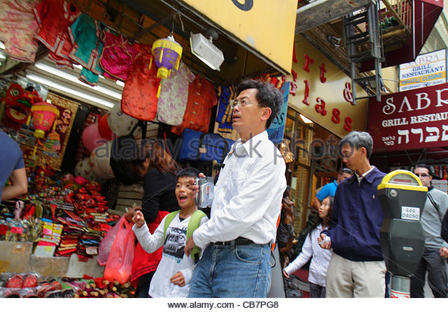 San Francisco California Chinatown Grant Street ethnic neighborhood shopping storefront Asian man boy girl father - Stock Image