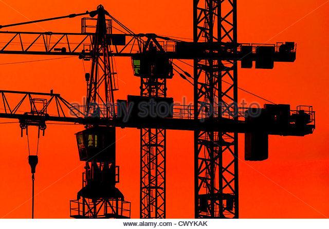 Construction cranes at dusk - Stock-Bilder