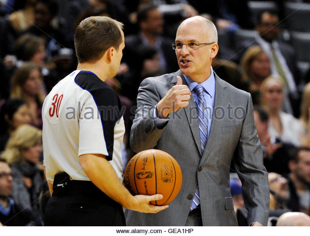Toronto Raptors head coach Jay Triano argues a call with official John Goble (L) during the first half of their - Stock Image