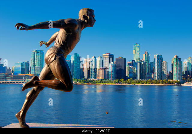 Statue of harry jerome with city in background in Stanley Park - Stock Image