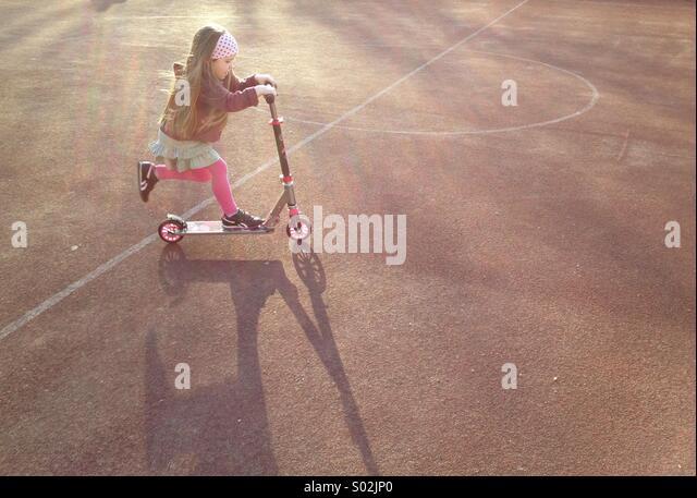 Child on scooter - Stock-Bilder