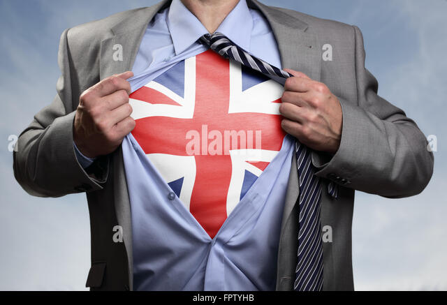 Superhero businessman revealing British flag - Stock Image