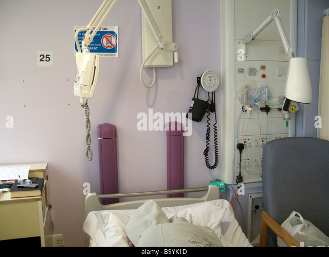 Hoody resting in NHS hospital bed UK oxygen panel part of a series RAW available (c) TW : EEC Photos moral rights - Stock Image
