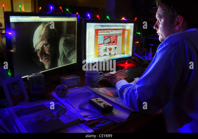 Late night last minute Christmas shopping at the PC - Stock Image