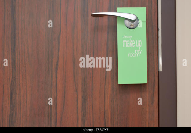 Please Make Up My Room Sign On Door Knob In Hotel  Stock Image