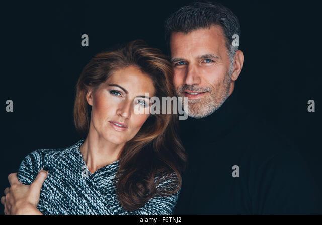Portrait of couple in front of black background - Stock-Bilder