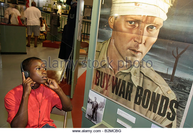Wisconsin Kenosha Simmons Island Kenosha History Center Black boy WWII World War Two war bonds poster education - Stock Image