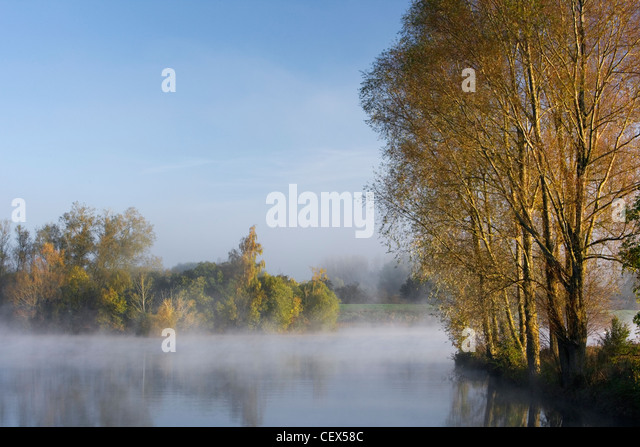 A misty autumnal dawn at Mallard Lake at the Wiltshire Wildlife Trust's new Lower Moor Farm nature reserve. - Stock Image