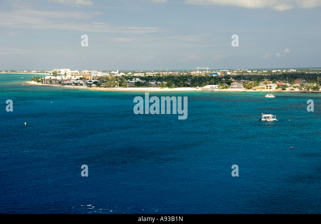 aerial George Town Grand Cayman  condos beach caribbean green water scenic landscape shoreline tour boats shoreline - Stock Image
