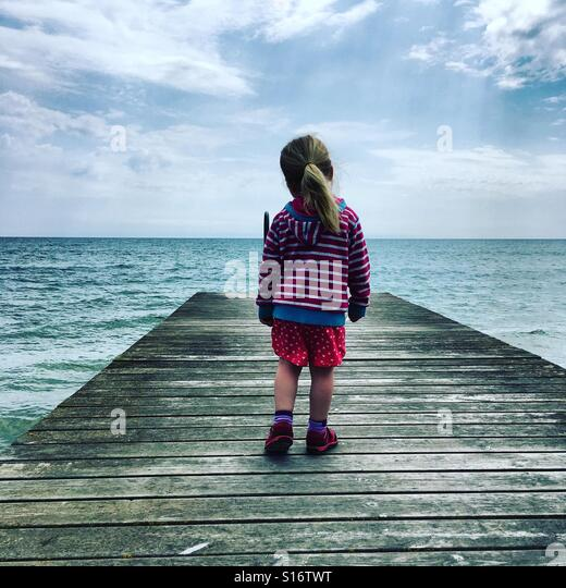 Girl is looking to the sea - Stock-Bilder