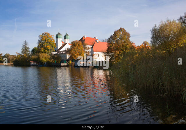 View over the monastery lake to Seeon monastery, Chiemgau region, Bavaria, Germany - Stock Image