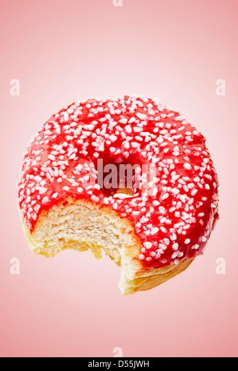 doughnut with bite taken - Stock-Bilder