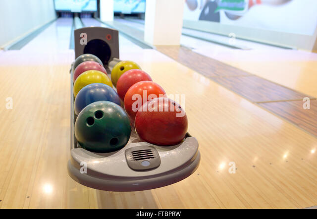 Colorful Bowling balls in ball return - Stock-Bilder