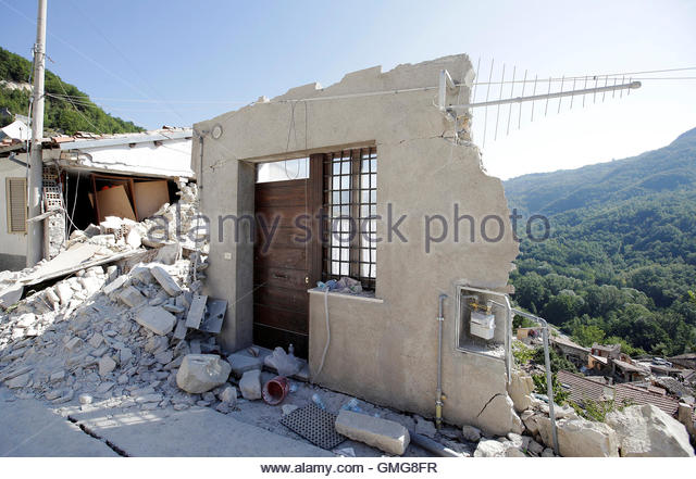 A front door of a collapsed house is seen following an earthquake in Pescara del Tronto, central Italy, August 26, - Stock-Bilder