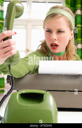 Young woman using phone - Stock Image