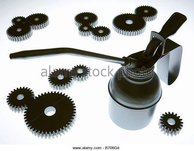 Cogs and oil can - Stock-Bilder