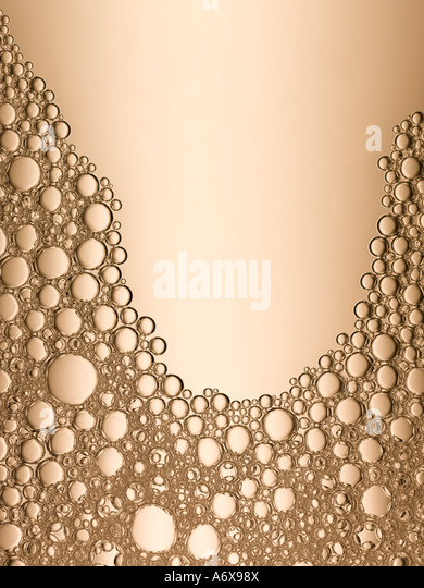 A close up of some golden bubbles - Stock Image