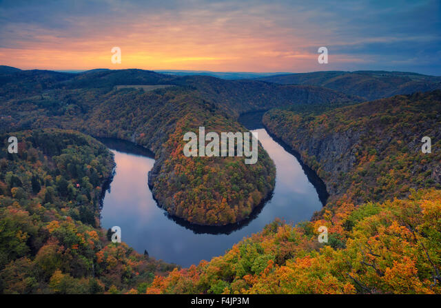 Autumn river bend. Beautiful meander of Vltava river in Czech Republic during autumn sunset. - Stock Image