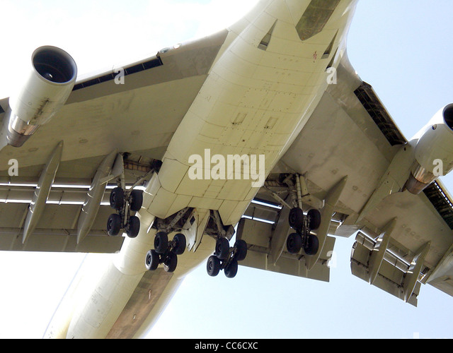 Wing and fuselage undercarriages on a Singapore Airlines Boeing 747-400 landing at London Heathrow Airport, England. - Stock Image