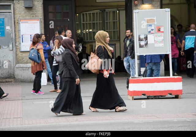 muslim women headscarf immigration migration - Stock-Bilder