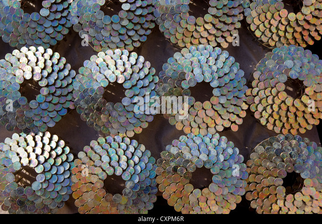 Rolls of nail gun roofing nails, design pattern - Stock Image