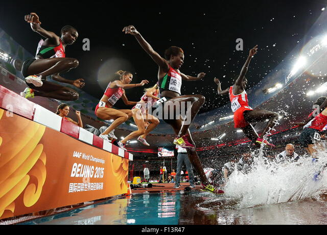 Beijing, China. 26th Aug, 2015. Athletes compete in the women's 3000m steeplechase final on Day 5 of the 15th - Stock-Bilder