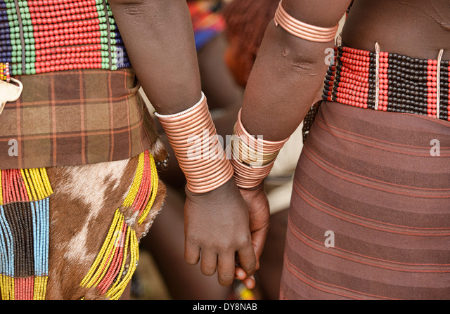 Hamer women with bracelets at a bull jumping ceremony near Turmi in the Omo Valley, Ethiopia - Stock Image