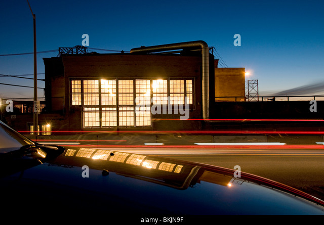Reflecting and blurred lights in industrial setting. - Stock Image