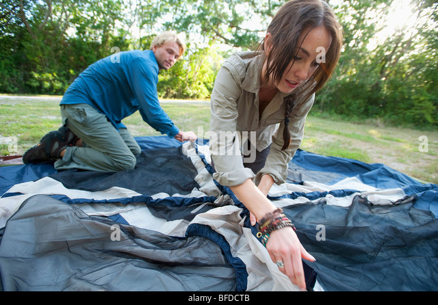 A couple set up a tent in Everglades National Park, Florida. - Stock Image