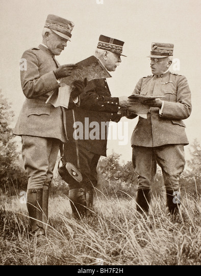 Italian General Porro, French General Joffre and Italian General Cadorna examining maps on the Italian Front in - Stock Image