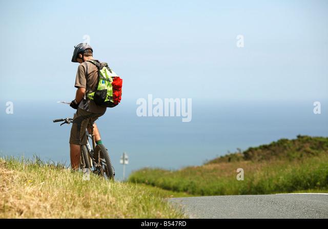 Mountain Biker Checking Map - Stock Image