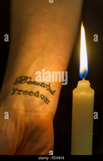 'Beautiful Freedom' tattoo on a woman, signifying the 1916 rising in Ireland and overcoming addiction isolated - Stock Image