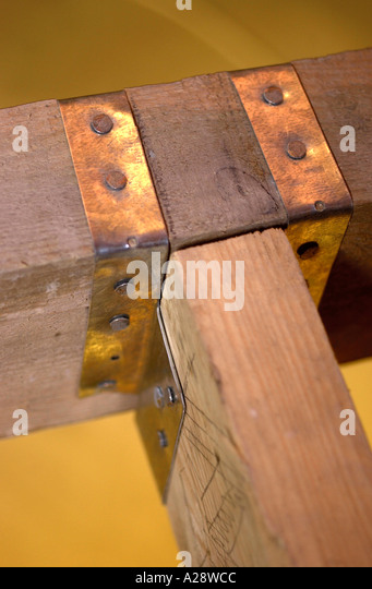 BUILDING AN EXTENSION TWO JOISTS SECURED WITH A STEEL JOIST HANGER - Stock Image