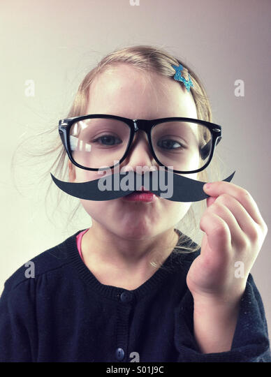 Little girl with big glasses and paper mustaches - Stock-Bilder