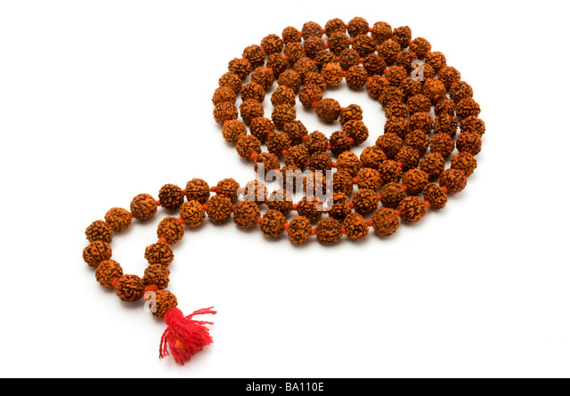 Japa Mala set of beads commonly used by Hindus and Buddhists on a white background - Stock Image