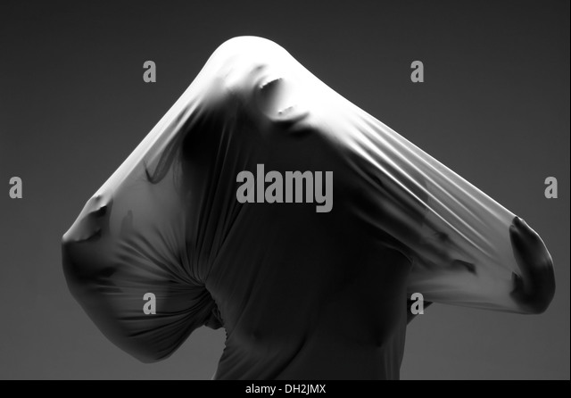 Horror Image of a Woman Trapped in Fabric - Stock Image