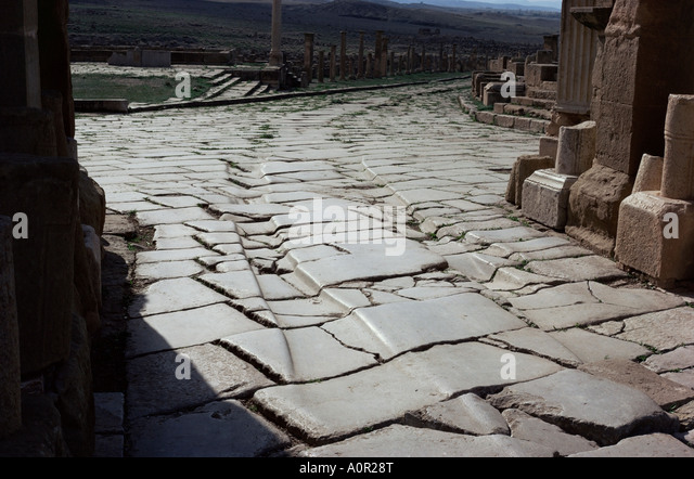 Chariot wheel ruts by the West Gate Roman site of Timgad UNESCO World Heritage Site Algeria North Africa Africa - Stock Image