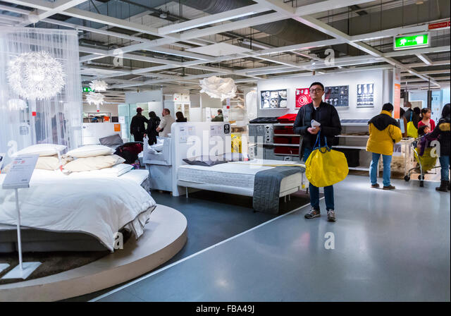 ikea store interior man looking stock photos ikea store interior man looking stock images alamy. Black Bedroom Furniture Sets. Home Design Ideas