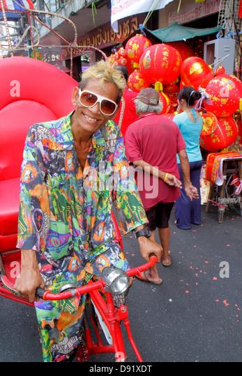 Bangkok Thailand Samphanthawong Chinatown Yaowarat Road Chinese New Year Asian man pedi-cab rickshaw - Stock Image