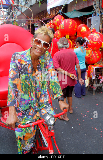 Thailand Bangkok Samphanthawong Chinatown Yaowarat Road Chinese New Year Asian man pedi-cab rickshaw - Stock Image