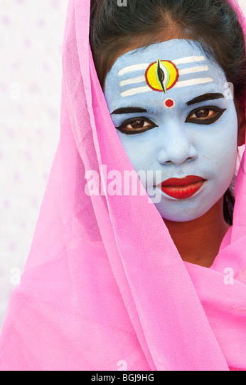 Indian girl with face painted as the Hindu god Shiva. India - Stock Image