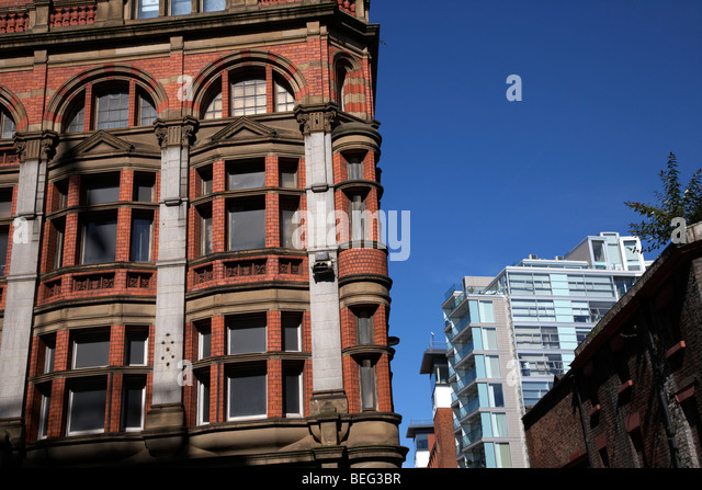 contrasting red brick and modern glass architecture in liverpool city centre merseyside england uk - Stock Image