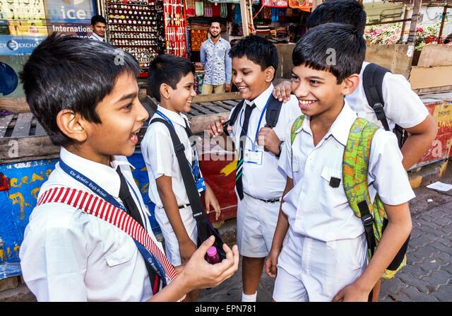 Mumbai India Asian Apollo Bandar Colaba Indumati Sakharkar Marg Colaba Causeway boy friends student uniforms The - Stock Image