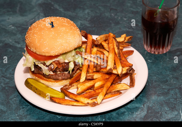 large double half pound burger fries and cola - Stock Image