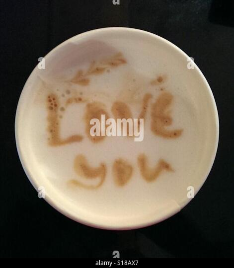Cappuccino cup saying 'love you' - Stock-Bilder