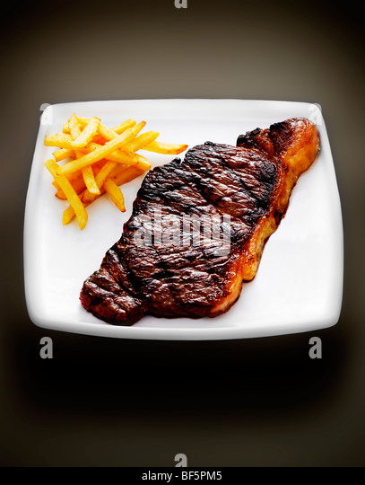 Steak and chips. - Stock Image
