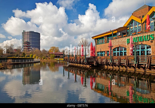 pond and nostalgic restaurant in front of Gasometer Oberhausen, Germany, North Rhine-Westphalia, Ruhr Area, Oberhausen - Stock Image
