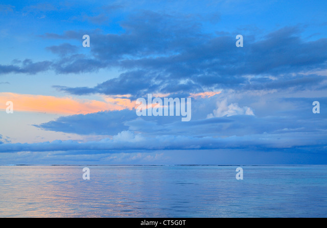 Morning twilight off the west coast of La Digue in the Seychelles - Stock Image